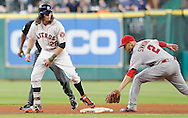 Jun 22, 2016; Houston, TX, USA; Houston Astros right fielder Colby Rasmus (28) with a stand up double as Los Angeles Angels shortstop Andrelton Simmons (2) applies the late tag in the fourth inning at Minute Maid Park. Mandatory Credit: Thomas B. Shea-USA TODAY Sports