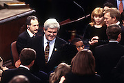 House Speaker Newt Gingrich talks to members on the House of Representatives floor after being re-elected Speaker January 7, 1997 in Washington, DC.