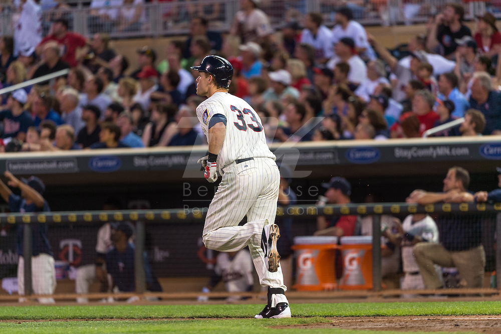 Justin Morneau #33 of the Minnesota Twins watches his home run against the Chicago White Sox on June 19, 2013 at Target Field in Minneapolis, Minnesota.  The Twins defeated the White Sox 7 to 4.  Photo: Ben Krause