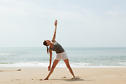 Jul. 25, 2012 - Woman practicing yoga on a beach (Credit Image: © Image Source/ZUMAPRESS.com)