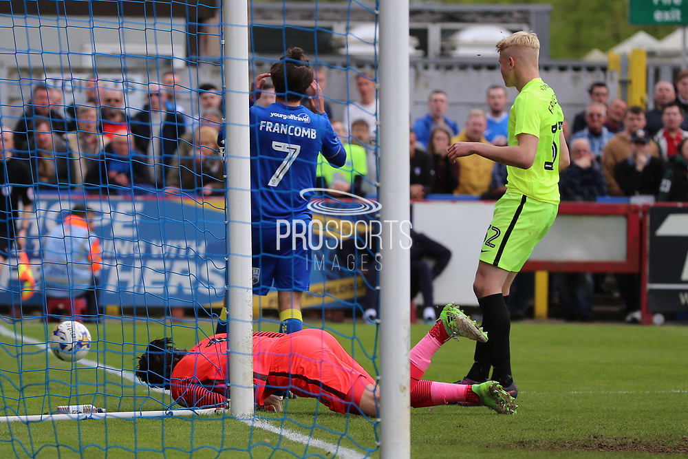 AFC Wimbledon defender George Francomb (7) after header was saved by Peterborough United goalkeeper Luke McGee (1) during the EFL Sky Bet League 1 match between AFC Wimbledon and Peterborough United at the Cherry Red Records Stadium, Kingston, England on 17 April 2017. Photo by Matthew Redman.