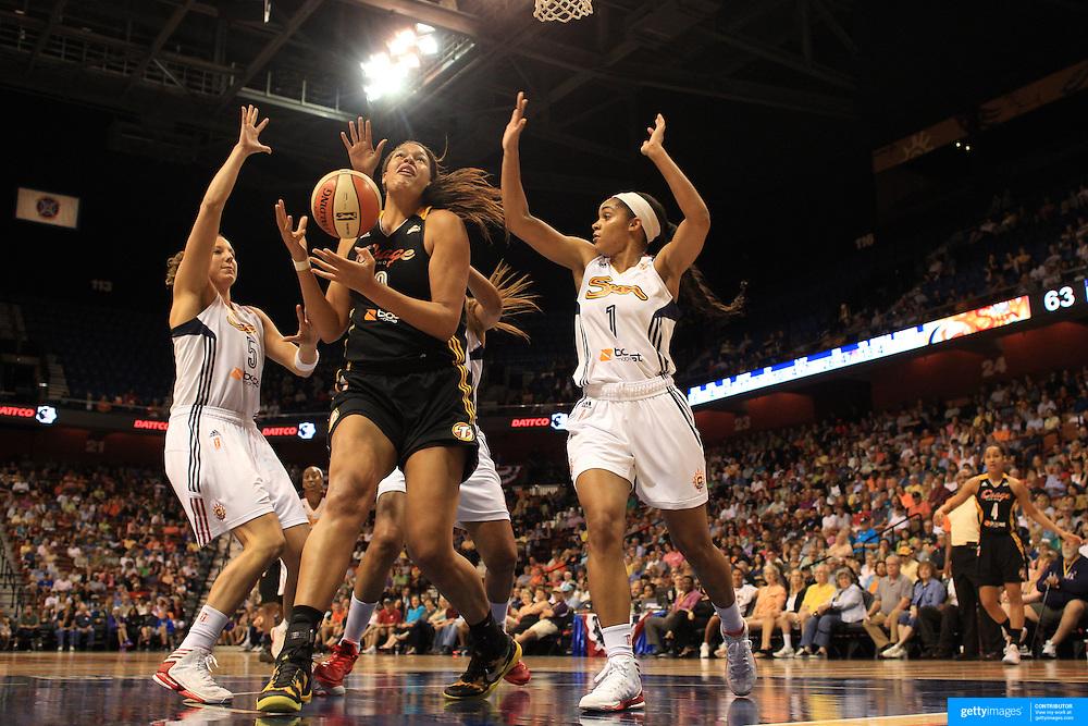 Elizabeth Cambage, Tulsa Shock, rebounds during the Connecticut Sun V Tulsa Shock WNBA regular game at Mohegan Sun Arena, Uncasville, Connecticut, USA. 2nd July 2013. Photo Tim Clayton