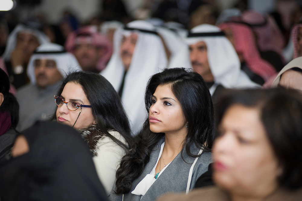 Kuwaiti women and men listen attentively as Safa Al-Hashem, a candidate in Kuwait's parliamentary elections next month, addresses a crowd attending the opening of her inaugural election HQ rally in Adailiah in Kuwait on 15 Jan. 2012. Al-Hashem, one of 340 candidates running in the Feb. 2 2012  election, laid out her plan to tackle what she said  were challenges facing Kuwait.