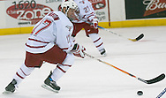 10/10/06 University of Nebraska at Omaha's Dan Swanson gains control of the puck vs Mantitoba during an exhibition game..(Chris Machian/Prairie Pixel Group)..
