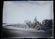 deteriorated glass plate of horse driven carriage with people
