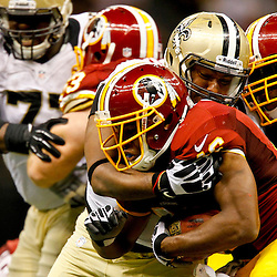 September 9, 2012; New Orleans, LA, USA; New Orleans Saints defensive end Will Smith (91) tackles Washington Redskins running back Alfred Morris (46) during the second half of a game at the Mercedes-Benz Superdome. The Redskins defeated the Saints 40-32. Mandatory Credit: Derick E. Hingle-US PRESSWIRE