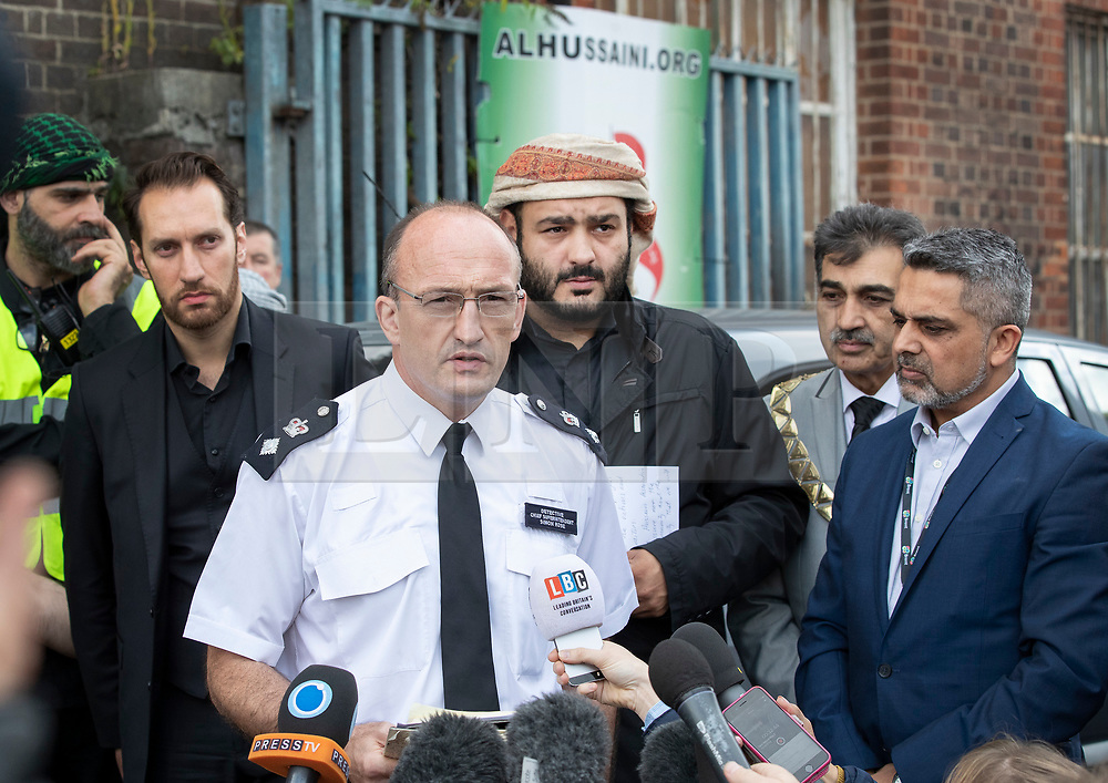 © Licensed to London News Pictures. 19/09/2018. London, UK. Detective Chief Superintendent Simon Rose (C) and Mustafa Al-Balaghi (3L) - a representive of The Hussaini Association Islamic Centre, talk to reporters in Cricklewood, north London where a car hit two pedestrians last night. The incident , which took place in the early hours of this morning outside the centre, is being treated as a possible hate crime. Police are looking for a male driver who failed to stop at the scene, as well as two men and one woman in the car, all in their 20s. Photo credit: Peter Macdiarmid/LNP