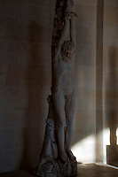 Statue of a crucified man at the Louvre, Paris