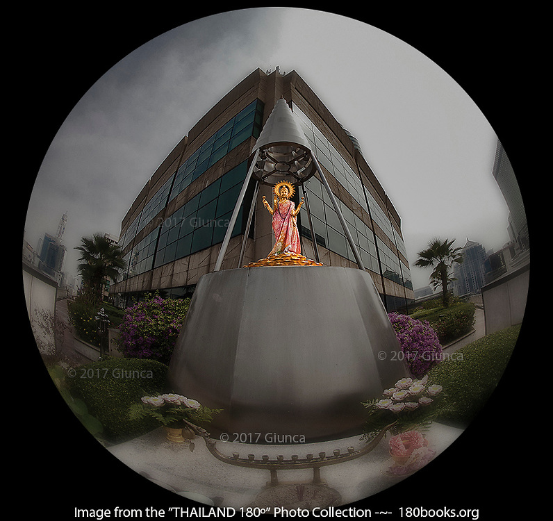 This statue of the Goddess Lakshmi sits high atop a luxury shopping mall in Bangkok, Thailand.