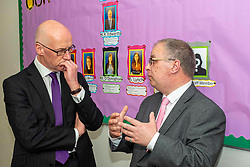 Pictured: John Swinney and teacher Kieth Edwards discussed nuermacy during the tour<br /><br />The Deputy First Minister visited Holy Rood High School in Edinburgh today to meet parents and pupils before announcing GBP50 million funding for improving attainment.  The results of a survey of headteachers were also published during the Deputy First Minister's visit.<br /><br /> Ger Harley | EEm 30 May 2019