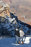 USA, Arizona, Grand Canyon. Two people look from Mathes Point, winter scene.