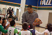 Utah Jazz player Derrick Favors takes on a whole new kind of defense during a private basketball clinic for local at-risk youth from the Dream Academy at the Zions Bank Basketball Center, Wednesday, Oct. 24, 2012.
