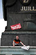 Protestor on the Colonne de Juillet, May Day March, Paris, 1 May 2009