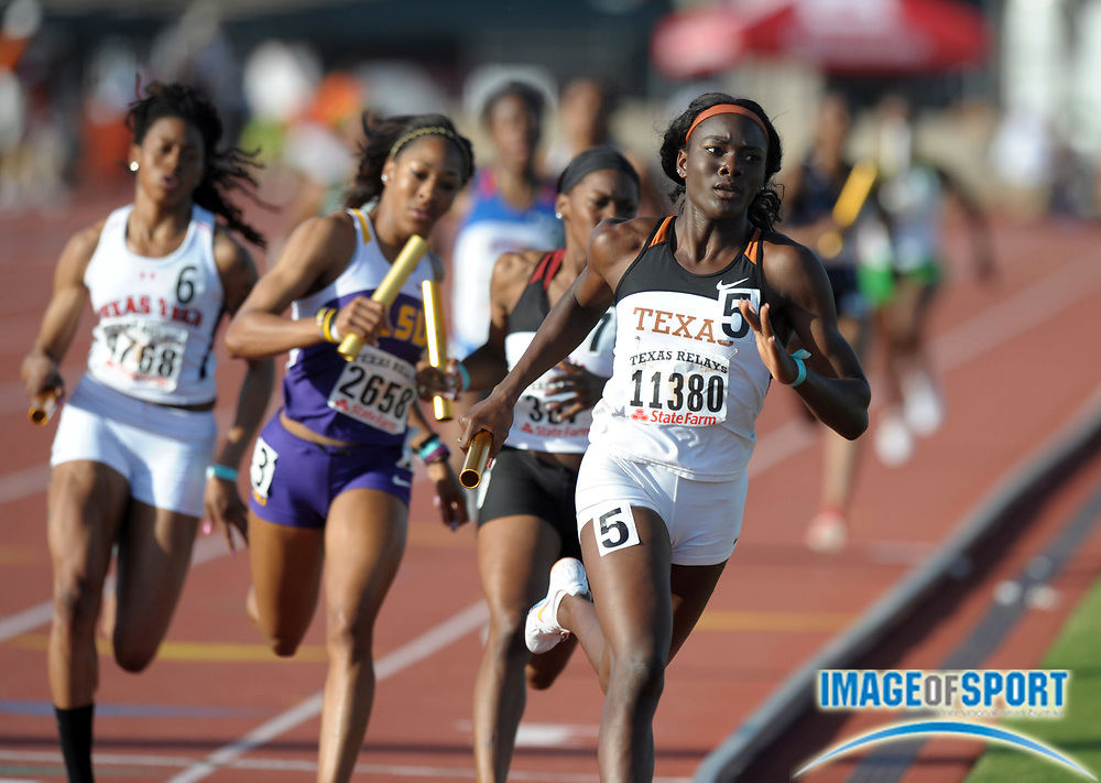 Mar 31, 2012; Austin, TX, USA; Kendra Chambers runs the third leg on the victorious Texas womens 4 x 400m relay in the 85th Clyde Littlefield Texas Relays at Mike A. Myers Stadium.