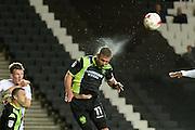 Bury striker Tom Pope (11) heads the ball during the EFL Sky Bet League 1 match between Milton Keynes Dons and Bury at stadium:mk, Milton Keynes, England on 27 September 2016. Photo by Dennis Goodwin.