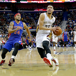 Dec 11, 2013; New Orleans, LA, USA; New Orleans Pelicans shooting guard Austin Rivers (25) drives past Detroit Pistons point guard Peyton Siva (34) during the second quarter at New Orleans Arena. Mandatory Credit: Derick E. Hingle-USA TODAY Sports