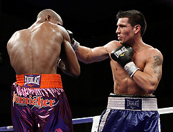 Dec 5, 2009; Atlantic City, NJ, USA; Paul Williams and Sergio Martinez trade punches during their welterweight bout at the Adrian Phillips Ballroom in Atlantic City, NJ.