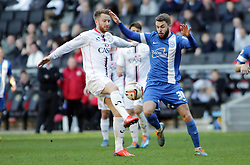 Peterborough United's Josh McQuoid in action with Milton Keynes Dons' Dean Bowditch - Photo mandatory by-line: Joe Dent/JMP - Mobile: 07966 386802 15/03/2014 - SPORT - FOOTBALL - Milton Keynes - Stadium MK - MK Dons v Peterborough United - Sky Bet League One