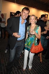DUNCAN BANNATYNE and CLAIRE DOBSON at the launch of 'Glenmorangie 5 Senses' an exhibition of photographs by Mike Figgis held at Proud Camden, Stables Market, London NW1 on 13th May 2008.<br />