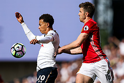 Dele Alli of Tottenham Hotspur is  challenged by Michael Carrick of Manchester United - Rogan Thomson/JMP - 14/05/2017 - FOOTBALL - White Hart Lane - London, England - Tottenham Hotspur v Manchester United - Premier League.