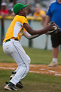 Erial's Adam Holland grabs a bunt as part of a double play during a Section 4 Little League final against Cherry Hill held in Gloucester Sunday night.