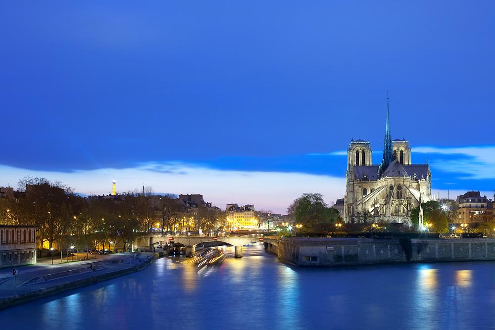 Notre Dame Cathedral on Ile de la Cite and Pont de l'Archeveche bridge over the Seine River, Paris, France