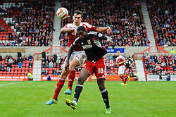 Bristol City Midfielder Jay Emmanuel-Thomas (ENG) and Swindon Defender Grant Hall (ENG) compete in the air during the second half of the match - Photo mandatory by-line: Rogan Thomson/JMP - Tel: 07966 386802 - 21/09/2013 - SPORT - FOOTBALL - County Ground, Swindon - Swindon Town v Bristol City - Sky Bet League 1.