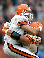 MORNING JOURNAL/DAVID RICHARD.Cleveland quarterback Trent Dilfer, left, is hoisted in the air by lineman Joe Andruzzi after Dilfer's second touchdown pass to Antonio Bryant in the fourth quarter yesterday against Chicago. Dilfer's two TD passes gave the Browns a come-from-behind win over the Bears and also helped new Cleveland coach Romeo Crennel earn his first home win.