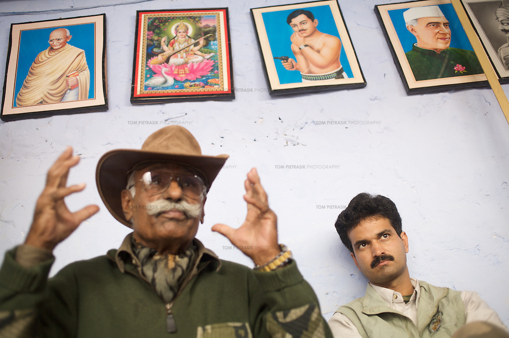 At the Tiger Watch Faludi town hostel for boys from the marginalised Mogia caste, Dharmendra Khandal, of Tiger Watch listens to colleague Fateh Singh who established Ranthambore National Park. Tiger Watch channels funds into the Mogia community by investing in alternative livelihoods and education. In doing so, Singh and Khandal hope to discourage Mogia people from hunting in Rathambore National park for bush-meat and tigers. Above the two men are pictures - among others - of Hindu goddess Laxmi, socialist hero Chandra Shekhar Azad and India's first Prime Minister Nehru. ..Sariska National Park in Rajasthan was once home to dozens of tigers but by 2005 poaching had resulted in their complete eradication. Recognising the urgent need for intervention, the Indian and Rajasthan-state governments began the reintroduction of tigers into Sariska. Two cats were airlifted 200 km from Ranthambore National Park in June 2008. On November 5th an attempt to relocate a third tiger was postponed until later in the month. This relocation strategy is certainly an important part of the tiger conservation effort but many, including those like Dharmendra Khandal of the NGO Tiger Watch, argue that it will never be entirely successful without properly confronting the three essential issues that threaten tiger populations: poaching, habitat loss and the hunting of prey-base animals. In turn, these three issues cannot be addressed without acknowledging the malign influence of caste, poverty and poor administrative accountability. Poaching is almost exclusively undertaken by extremely poor and marginalised groups, including the Mogia caste who, without education, land and access to credit have limited alternative means of income. Many in the Mogia community also hunt bush meat for both their own consumption and to sell to others. This results in a depletion of the prey-base upon which tigers feed. Encroachment and grazing by those including the Gujar people who raise dairy herds, have led to