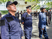29 NOVEMBER 2013 - BANGKOK, THAILAND: Thai riot police in front of the US Embassy in Bangkok. Several thousand Thai anti-government protestors marched on the US Embassy in Bangkok. They blew whistles and asked the US to honor their efforts to unseat the elected government of Yingluck Shinawatra. The anti-government protestors marched through several parts of Bangkok Friday paralyzing traffic but no clashes were reported, even after a group protestors tried to occupy Army headquarters.       PHOTO BY JACK KURTZ