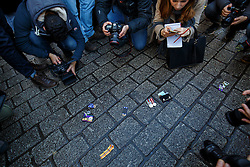 © Licensed to London News Pictures. 08/12/2015. London, UK. Members of media taking pictures of medals thrown down by veterans outside Downing Street in a protest against the attack on Syria. The protest is organised by Veterans For Peace on Tuesday, 8 December 2015. Photo credit: Tolga Akmen/LNP