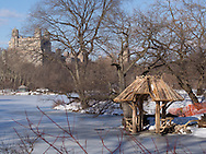 The Lake in Central Park with the newly renovated rustic shelter of Wagner Cove.