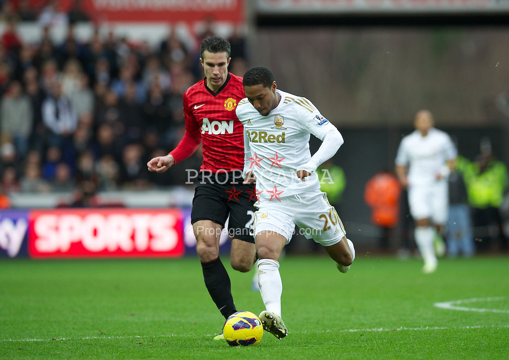 SWANSEA, WALES - Sunday, December 23, 2012: Manchester United's Robin van Persie in action against Swansea City's Jonathan De Guzman during the Premiership match at the Liberty Stadium. (Pic by David Rawcliffe/Propaganda)