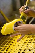 Klompen worden met de hand geschilderd. Produktie bij de grootste klompenfabriek ter wereld, Klompenfabriek Nijhuis B.V. in Beltrum. Voor de productie van klompen worden speciale en zelf ontwikkelde machines gebruikt. Hoewel het principe al erg oud is, worden de productietechnieken nog steeds verbeterd.<br /> <br /> Wooden shoes are hand painted. Production at the biggest manufacturer of wooden shoes, Klompenfabriek Nijhuis B.V. at Beltrum (NL). For the production special and self developed machines are used. Although the principe of the manufacturing is very old, the techniques are still being improved.