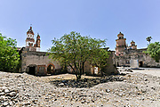 The ruins of a courtyard looking toward the front at the fading Hacienda de Jaral de Berrio in Jaral de Berrios, Guanajuato, Mexico. The abandoned Jaral de Berrio hacienda was once the largest in Mexico and housed over 6,000 people on the property and is credited with creating Mescal.