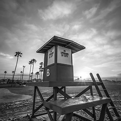Newport Beach California Lifeguard Tower B sunrise black and white photo. Newport Beach is a popular coastal beach city in Southern California in the United States of America. Photo is high resolution. Copyright ⓒ 2017 Paul Velgos with All Rights Reserved.