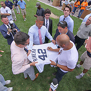 Former New York Yankees All-Star pitcher Mariano Rivera (RIGHT) autograph a baseball jersey for U.S. Senator Christopher Coons staff members during a backpack give-away sponsored by Mariano&quot; organization &quot;The Mariano Rivera Public Foundation&quot; Monday, August. 14 2017, at Rodney Square in Wilmington Delaware.<br /> <br /> More than 1,500 backpacks filled with back-to-school supplies was given to children in grades K through 5th grade.