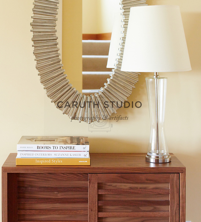 How to Style an Entry Table: Balance lamp with a stack of books