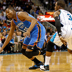 January 24,  2011; New Orleans, LA, USA; Oklahoma City Thunder small forward Kevin Durant (35) drives past New Orleans Hornets point guard Chris Paul (3) during the fourth quarter at the New Orleans Arena. The Hornets defeated the Thunder 91-89. Mandatory Credit: Derick E. Hingle