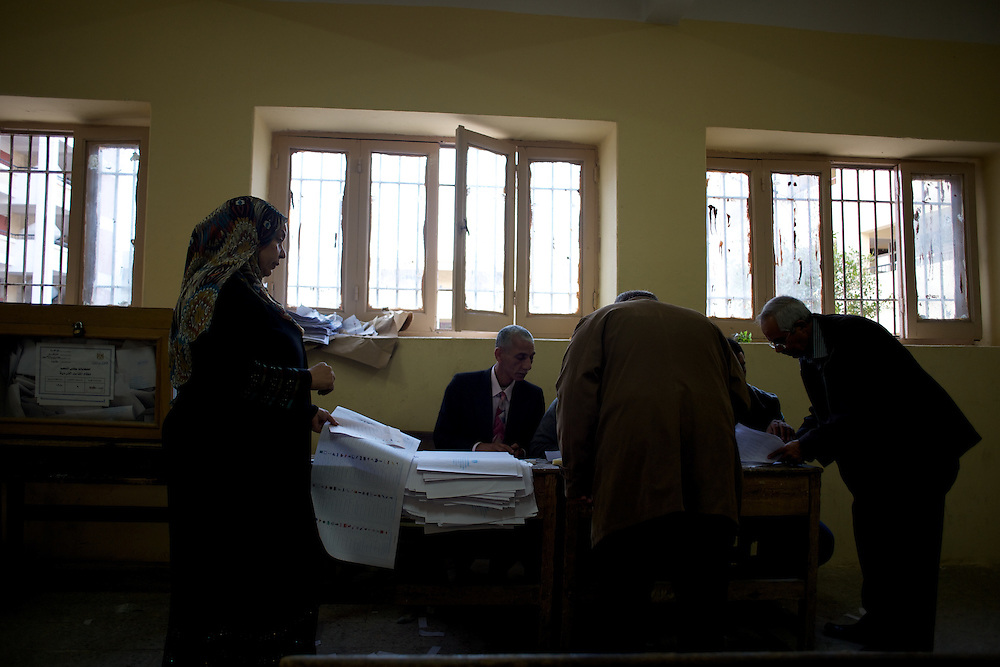People vote in a polling station at Masr El Gdeeda district in Cairo.