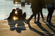 Nederland, Amsterdam, 13 maart 2016<br /> Stelletje aan de waterkant.<br /> <br /> Foto (c) Michiel Wijnbergh