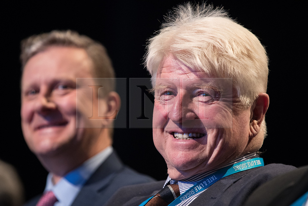 © Licensed to London News Pictures  . 03/10/2017 . Manchester , UK . Boris Johnson's father STANLEY JOHNSON laughs at a joke about £350 million made by Secretary Michael Fallon's keynote speech , on day three of the Conservative Party Conference at the Manchester Central Convention Centre . Photo credit : Joel Goodman/LNP