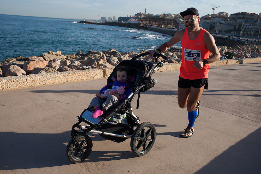 Tel Aviv Samsung Marathon  February 27, 2015<br /> Some 35,000 runners participated in the marathon, which was rescheduled to an earlier hour in the morning in anticipation of the heat wave which reached its peak later in the day.<br /> Runner William Kiprono Yegon of Kenya broke the marathon record, crossing the finish line with the clock at 2:10:30. Second and third places were captured by Kenyan runners Joyce Kilimo and Munyeki Charles.<br /> <br /> The first Israeli to cross the finish line was Ran Alterman, who completed the race in two hours and 37 minutes.<br /> <br /> <br /> photographer - Gilad Kavalerchik<br /> <br />    www.Giladka.com