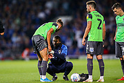 AFC Wimbledon defender Nesta Guiness-Walker (18) receives treatment during the EFL Sky Bet League 1 match between Ipswich Town and AFC Wimbledon at Portman Road, Ipswich, England on 20 August 2019.