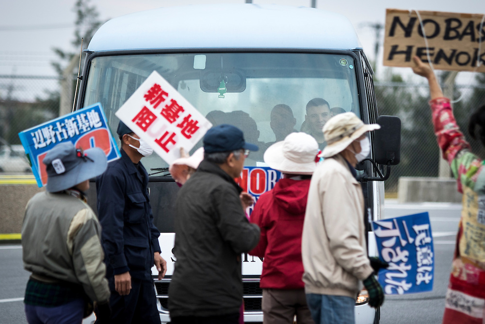 OKINAWA, JAPAN - FEBRUARY 1 : Anti U.S. Base protesters shout with placards and block the cars of US marines from getting out of the U.S Marine Camp Schwab, protesting against the construction of the new U.S Marine Airbase in Nago, Okinawa, Japan on Wednesday, February 1, 2017. Okinawa Gov. Takeshi Onaga arrived in the United States on Tuesday, aiming to convey to President Donald Trump's administration local opposition to a plan to relocate a U.S. airbase within the southern island prefecture. (Photo by Richard Atrero de Guzman/NURPhoto)
