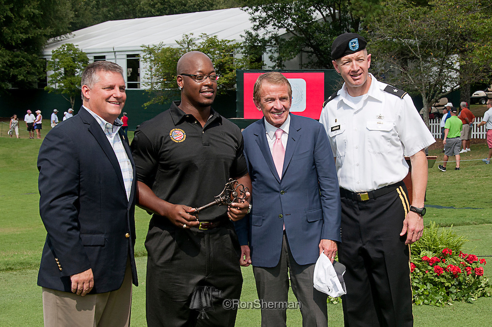 Military veteran Rickylee Pinkey (2nd from left) accepting mortgage free home, with BG Jarrard on right.