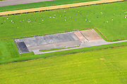Nederland, Groningen,, 27-08-2013; uitgeput aardgasveld met afgesloten boorputten. Kolham, ten zuidwesten van het dorp Slochteren. In de omgeving van Kolham is in 1959 het Groningen-gasveld ontdekt.<br /> Natural gas plant with wells and pumping station, southwest of the village Slochteren. In this area the Groningen gas field was discovered in 1959.<br /> luchtfoto (toeslag op standaard tarieven);<br /> aerial photo (additional fee required);<br /> copyright foto/photo Siebe Swart.