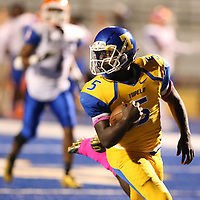 Tupelo running back Jaquerriuos Williams looks over his shoulder as he goes into the endzone for one of his three touchdowns in the first half against Southaven Friday night.