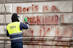 © Licensed to London News Pictures. 07/06/2020. London, UK. The words 'Boris is a dickhead' are painted with a cleaning solution before being power washed off the walls of The Foreign Office in Whitehall after yesterday's Black Lives Matter protest march . New quarantine rules on passengers entering the United Kingsom come into force tomorrow. People entering the country will have to quarantine for two weeks. Photo credit: Peter Macdiarmid/LNP