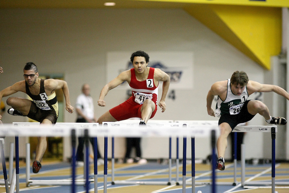 Windsor, Ontario ---13/03/09--- \cisright to left, Iain McCormick of  the University of Saskatchewan (263), Elijah Allen of  York University (412), and Kieran Moolchan of  the University of Manitoba (202)\ competes in the 60m Hurdle Prelims at the CIS track and field championships in Windsor, Ontario, March 13, 2009..Sean Burges Mundo Sport Images